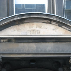 Shadow of Medical School sign on the pediment.