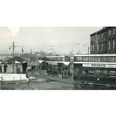 Black and white photograph of Granton Square in 1955, with two trams running down the street