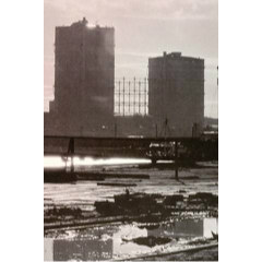 Sepia photograph of the three separate gas holders at Granton Gasworks..