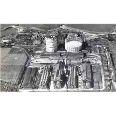 A black and white aerial photograph of Granton Gas Works showing the gasworks, the Caledonian Railway lines going into the site and the station building.