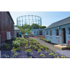 Photograph of the Social Bite village with the Gas Works behind it