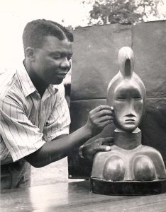 Oku Ampofo with one of his sculptures